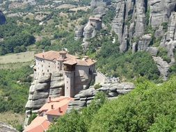 top view of ancient monastery on rock, greece, meteora