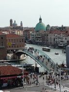 people walking on constitution bridge in city, italy, venice