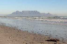 view of table mountain from ocean beach, south africa, cape town