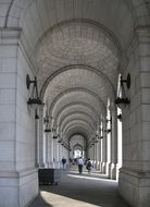 people walking in arched passage of union station building, usa, washington dc