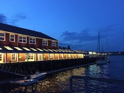 restaurant with boardwalk on waterfront at dusk,canada, nova scotia, halifax
