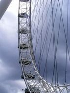 london eye ferris wheel, detail at clouds, uk, england
