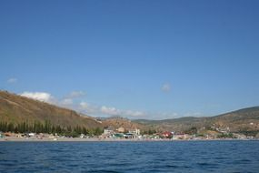 beach and village on coastline at mountains, russia, crimea