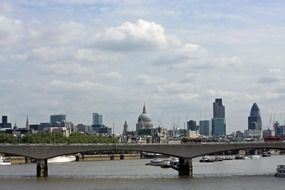 st paul's cathedral and gherkin buildings in city skyline from thames, uk, england, london