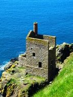 ruined engine house of botallack mine on cliff at sea, uk, england, cornwall, st just