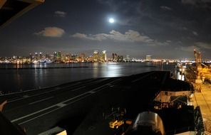 distant view of city at full moon night from harbour, usa, california, san diego