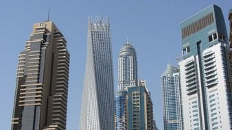 The Marina Torch among skyscrapers at sky, uae, dubai
