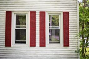 red shutters white wooden facade house