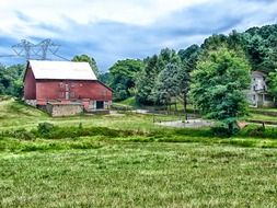 red farm building in rural summer landscape, usa, pennsylvania