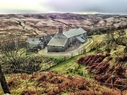 sleddale hall, top view of old farmhouse in valley, uk, england