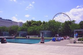 people resting at pool in city park at summer, hungary, budapest