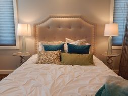 bedroom with pillows on bed at head board