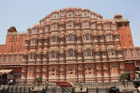 aged red and pink sandstone palace of winds, india, rajasthan, jaipur