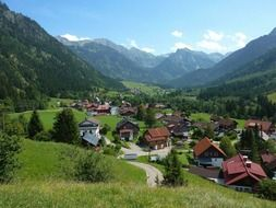 village in valley among forested mountains at summer, germany, hinterstein