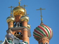 domes of orthodox church with golden crosses at blue sky, russia, voronezh