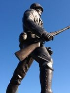 first world war soldier with rifle, side view, bronze monument