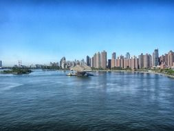 distant view of modern city at water, usa, nyc