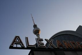 alexanderplatz letterung and tv tower at sky, germany, berlin