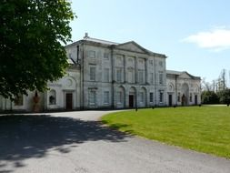 cams hall, palladian mansion in park at summer, uk, hampshire