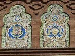 ceramic tiles ornament at brick wall, spain. madrid