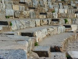 ancient stone benches in ruins of theater, turkey, ephesus