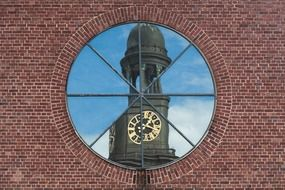 reflection of church tower in a window