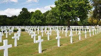lot of white stone crosses on military cemetery, usa