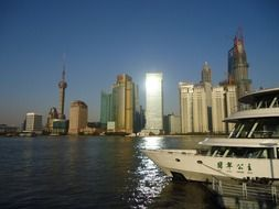 boat on water at skyline of modern city, china, shanghai