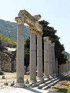 ancient classical columns among ruins, turkey, efes