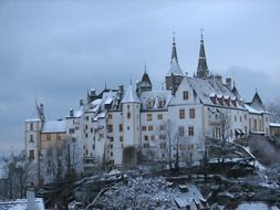 Chateau de Neuchatel, aged castle on hill at winter, switzerland