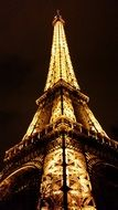 low angle view of illuminated eiffel tower at dark sky, france, paris