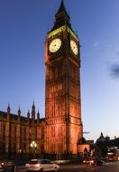 illuminated big ben tower at parliament building in dusk, uk, england, london