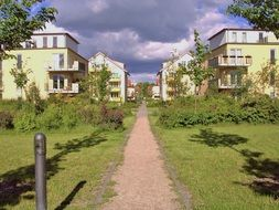 walk path to new buildings in residential complex, germany, brandenburg