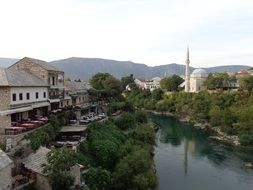 mosque in old town at river, bosnia and herzegovina, mostar