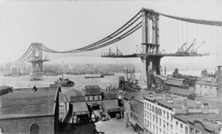 oldtime view of suspension manhattan bridge under construction, usa, new york city