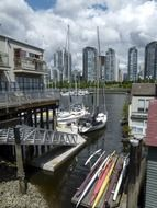 anchored sailing boats in view of city, canada, vancouver, false creek harbor