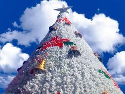 blue sky over white christmas tree
