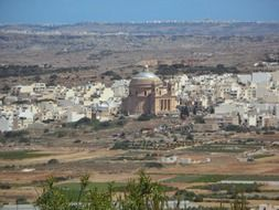 distant view of the dome church in mgarr in Malta