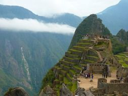 Machu Pikchu is a 15th-century Inca citadel situated on a mountain ridge