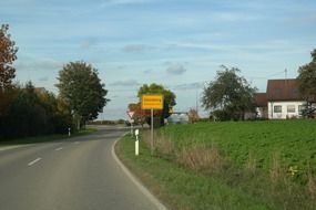 yellow sign of town steinberg on the road