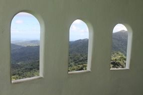 view of the hills from arched windows
