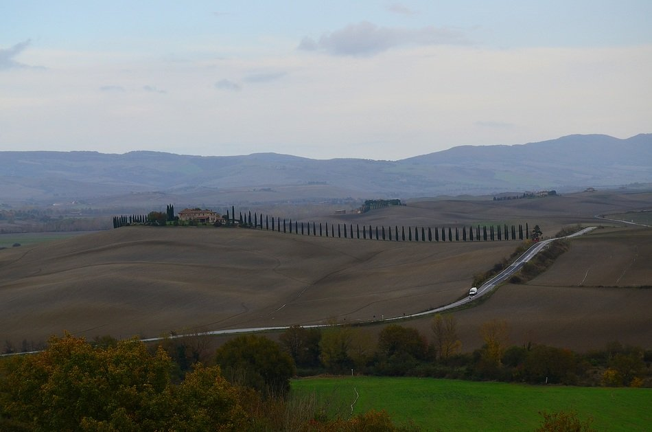 road across hills in beautiful rural landscape, italy, tuscany