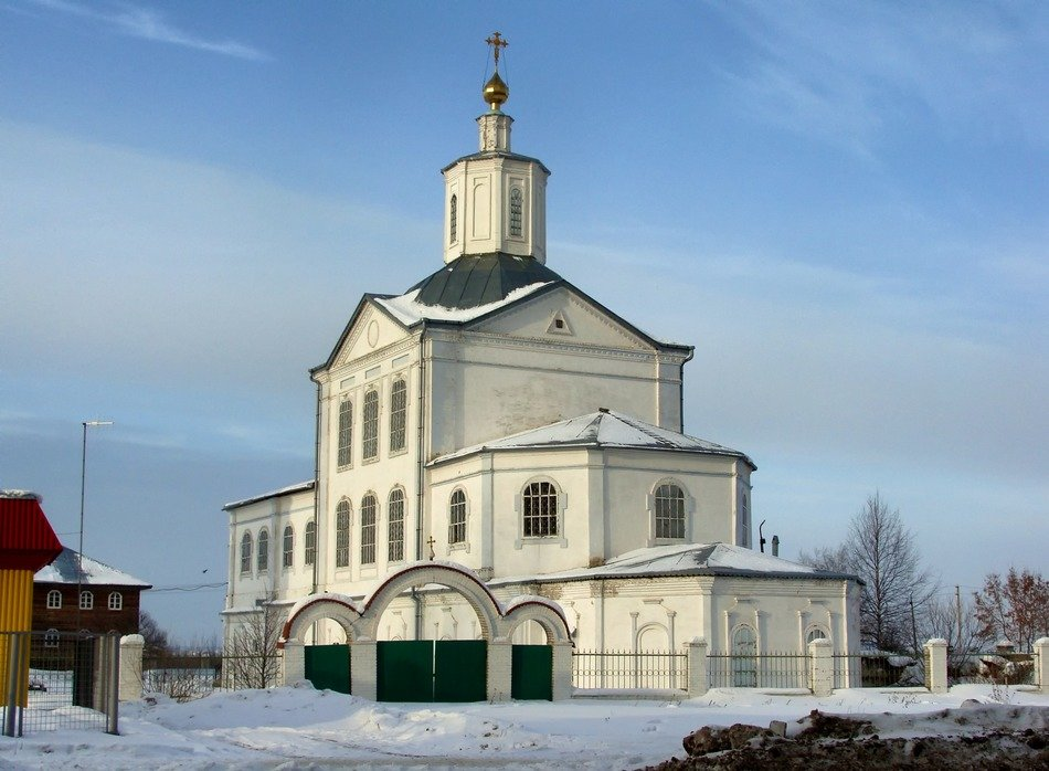 white orthodox church at winter in countryside in Russia