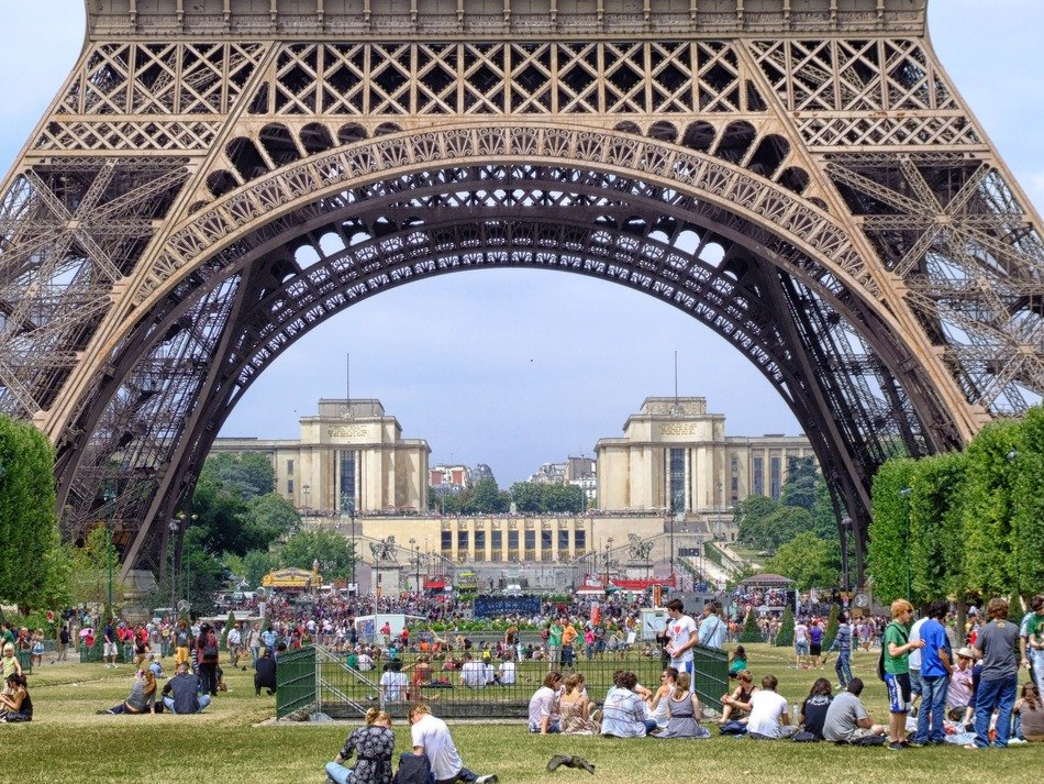 people resting on lawn at eiffel tower at summer, france, paris