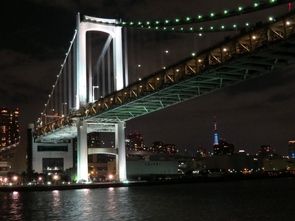 low angle view of rainbow bridge at night, japan, tokyo