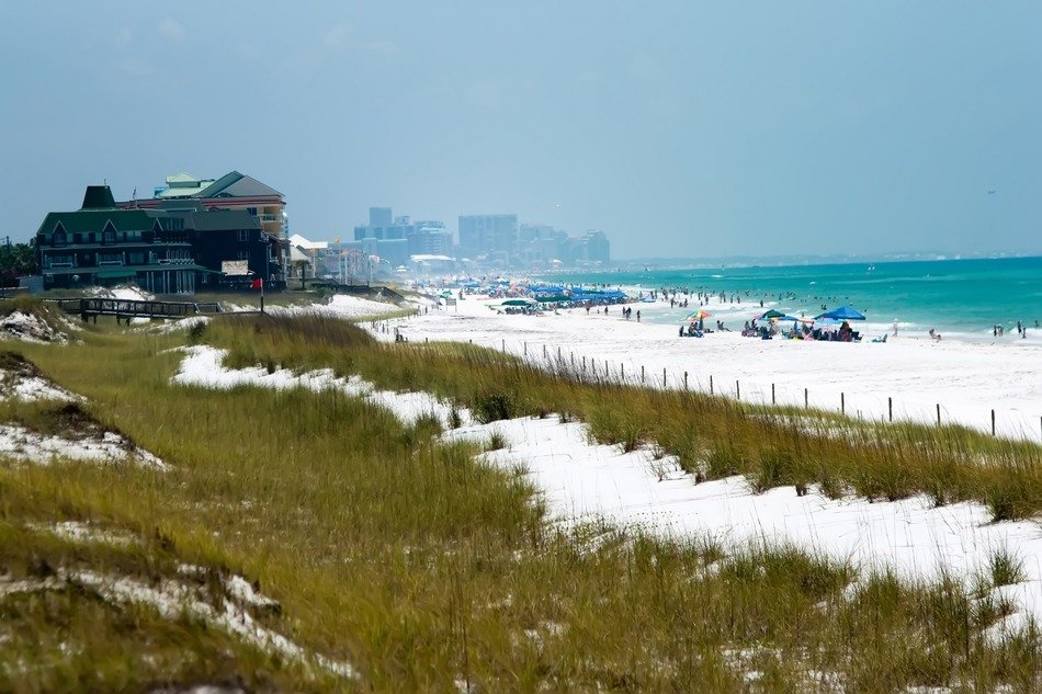 people on sand beach at distant city, usa, florida, gulf mexico
