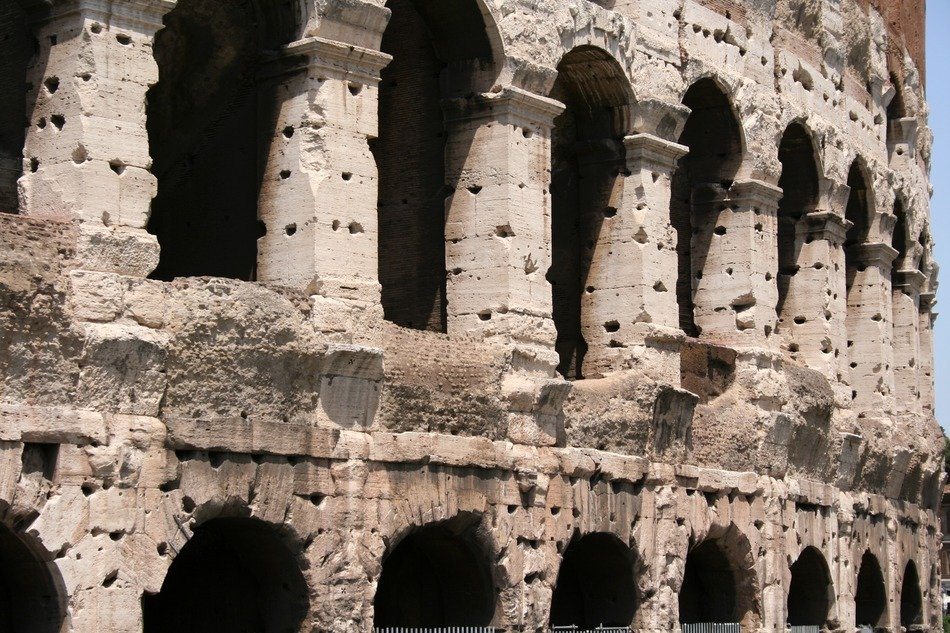 close up of ancient colosseum wall, italy, rome