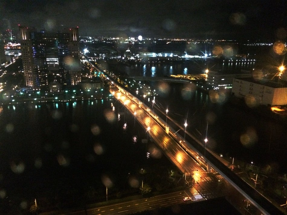 top view of night city in rainy season, japan, tokyo