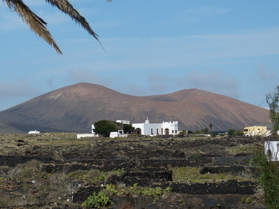 distant white building at volcano, spain, canary islands, lanzarote