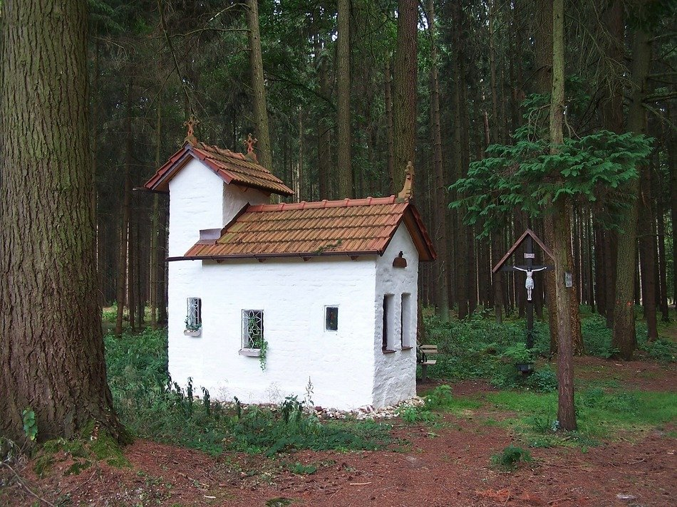 small old white chapel in forest, germany